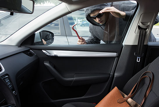 Thief Looking for Valuables in a Car thumbnail