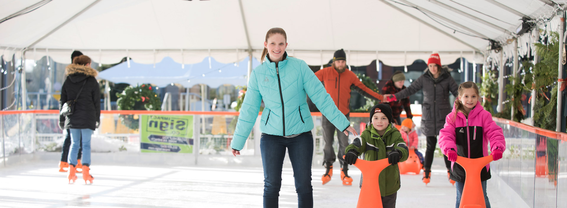 Image of family ice skating at Winter Village