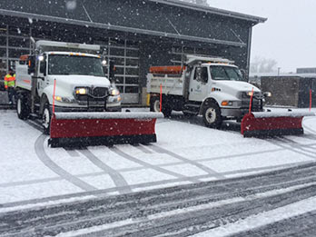 Photo of Snow Plows in front of the City of Hillsboro Public Works Department's Fleet Facility