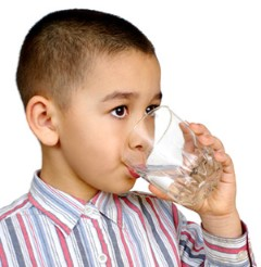 Child Drinking Tap Water from a Glass Cup