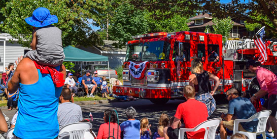 4th of July Parade atendees watching a City of Hillsboro fire engine on the parade route