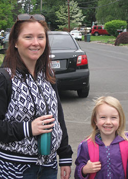 A mother and daughter walk to school together as part of the Safe Routes to School program