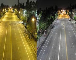 A photo comparing high pressure sodium street lights to light emitting diode lights.