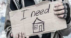 "Person holding a sign that sayd ""I need a home"""