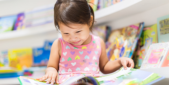 Asian Little Girl with Book