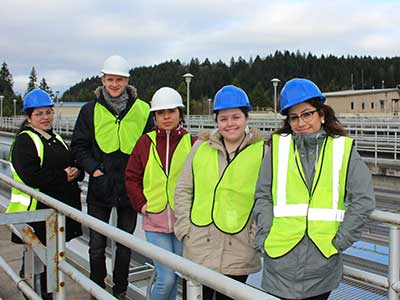 JTOP employees pose in hard hats at the water treatment plant