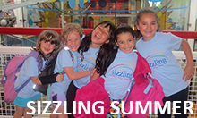Photo of five Sizzling Summer Day Camp campers laughing and having fun on a field trip.