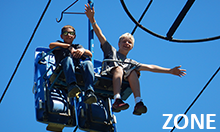 Photo of two boys riding ski lift at the Zone Adventure Camp.