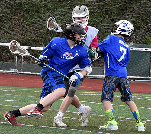 Photo of boys playing lacrosse game.