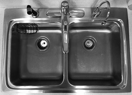 Sink screens positioned in sink drains to catch food waste