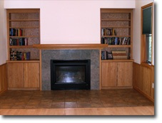 Photo of the River House fireplace and bookcases.