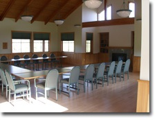 Photo of the Great Room at the River House showing tables and chairs set up for a meeting.
