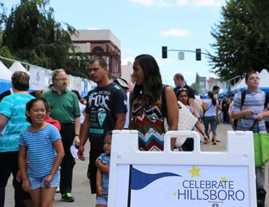 Family enjoying Celebrate Hillsboro on Main Street downtown Hillsboro.