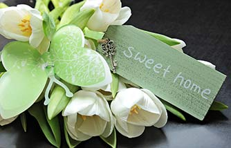 "Image of flowers and tag that says ""sweet home"""