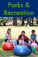 Parks & Recreation E-News Text and photo of kids bouncing on brightly colored exercise balls at a park
