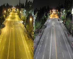 Photo comparing High Pressure Sodium lighting next to LED street lighting