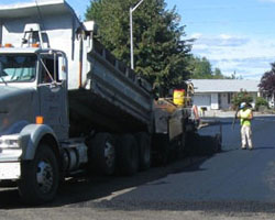Asphalt pour during annual pavement overlay maintenance