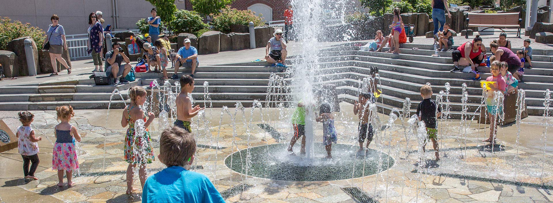 Children play at the Civic Center Fountain and sprayground