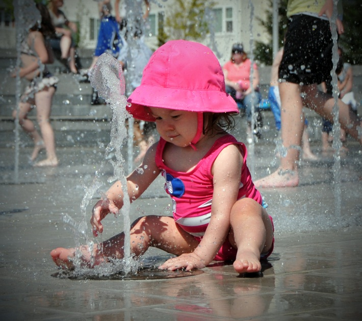 Little girl playing at 53rd sprayground