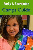 Parks & Recreation Camps Guide. A young girl shows off her artwork.