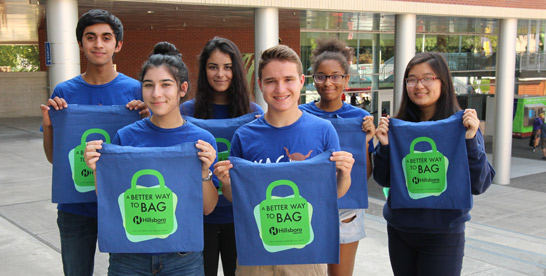 Youth Advisory Council students holding reusable shopping bags