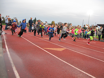 Children running on track at annual Parks & Recreation Turkey Trot.