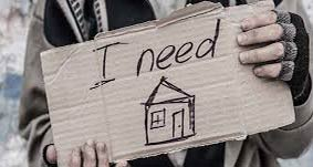 "Hands hold a sign that states, ""I need a home"""
