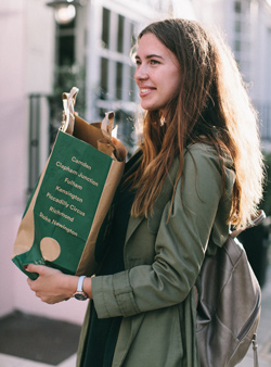 Woman carrying a paper grocery bag