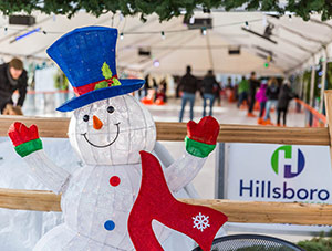 A snowman greeting skaters under the tent at the Winter Village ice rink.