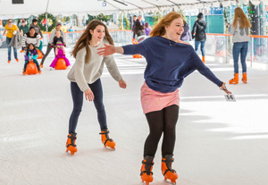 Two girls skating at Winter Village