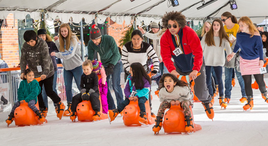A group of people skating at Winter Village
