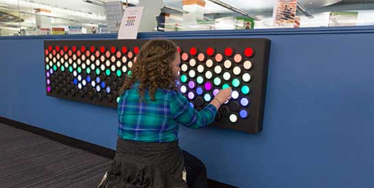 Little girl making colored strips on Everbright Lightwall