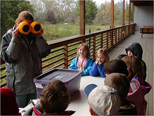Young students having fun learning about Jackson Bottom Wetlands Preserve.