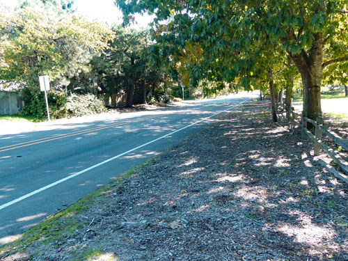 A stretch of Jackson School Road that does not have sidewalks on other side