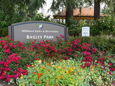 Bagley Park entrance with flowers and sign
