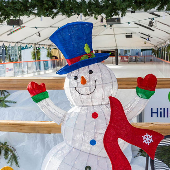 An friendly snowman greets skaters at the Winter Village ice rink