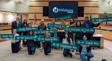 Members of the 2019 Civic Leadership Academy pose with Hillsboro street signs with their last names