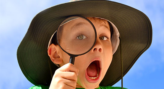 Boy-with-Magnifying-Glass_546x298