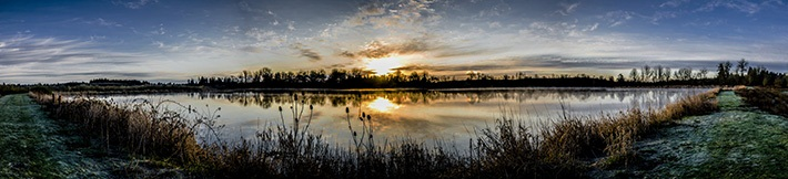 Photo of sunrise over wetlands by John Wise