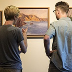Image of two patrons viewing artwork in the gallery