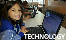 Photo of young girl sitting at computer in a technology camp.