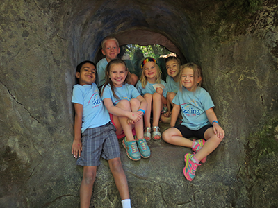 Sizzling Summer kids in cave at Enchanted Forest.