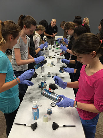 Photo of SPLASH Students dusting for fingerprints.