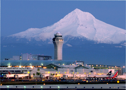 Image of Portland International airport with Mount Hood in the background.