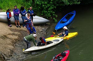 Kayakers launching from existing boat ramp