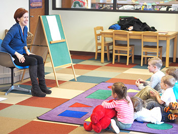 A woman reading to children