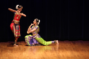 Dancers performing on stage.