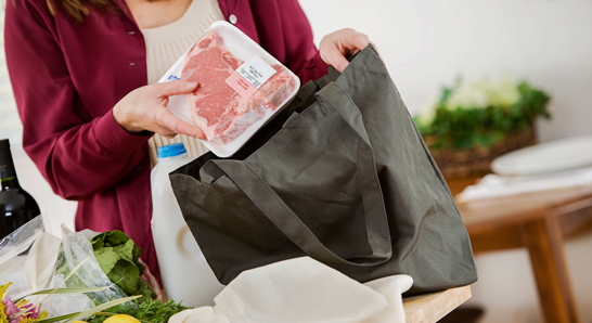 Woman using a reusable grocery bag