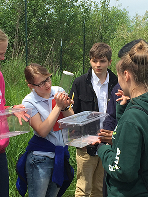 Students using scientific tools to collect ecosystem information at Jackson Bottom Wetlands Preserve