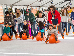 Parents and kids skating at Winter Village.